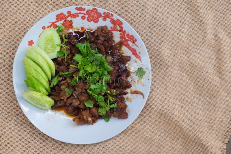 Casalingo tailandese, scalpore dell'alimento ha fritto la carne di maiale con lo zucchero fotografia stock