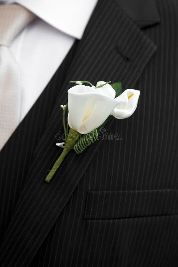 Casarse el traje con el ramillete imágenes de archivo libres de regalías