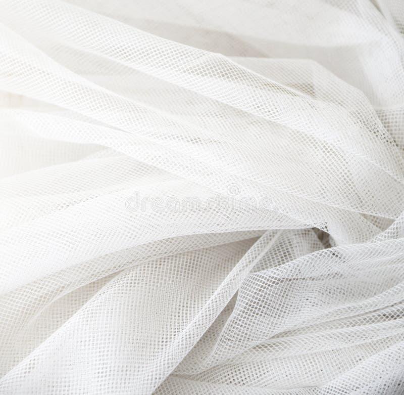 Casarse la tela transparente de seda blanca Fondo suave abstracto de la textura de la gasa Gasa blanca suave con la curva y la on imagen de archivo