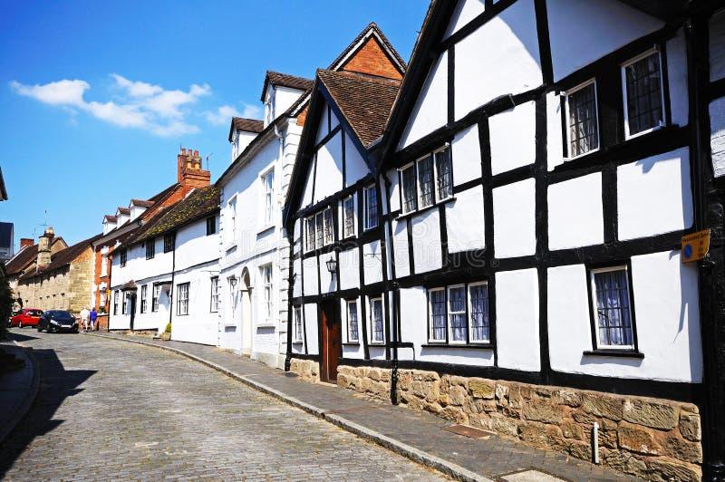 Casas ao longo da rua do moinho, Warwick fotografia de stock