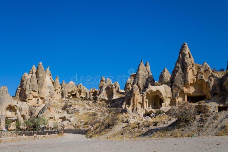 Casas bonitas da caverna da paisagem de Cappadocia fotografia de stock royalty free