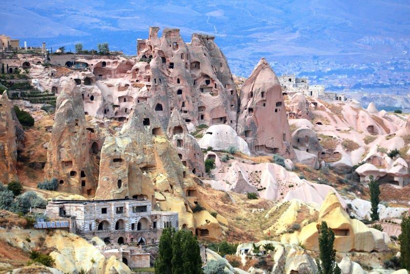 Casas cinzeladas na rocha, vale do pombo, Uchisar, Cappadocia, Turquia imagens de stock
