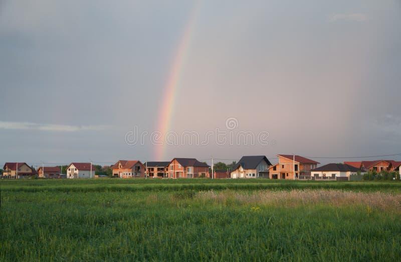Casas con el arco iris foto de archivo libre de regalías