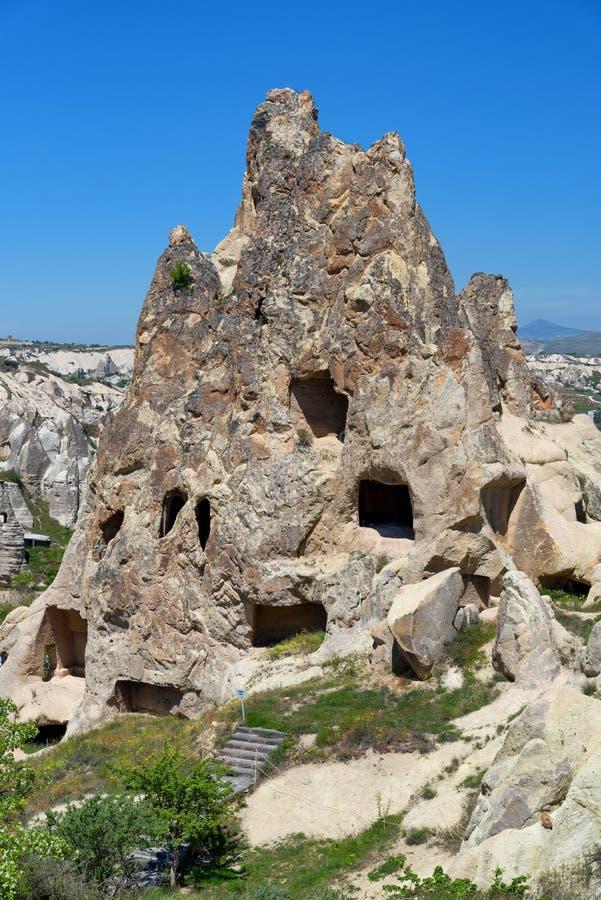 Casas da caverna do corte da rocha, parque nacional de Goreme, Cappadocia Turquia imagem de stock