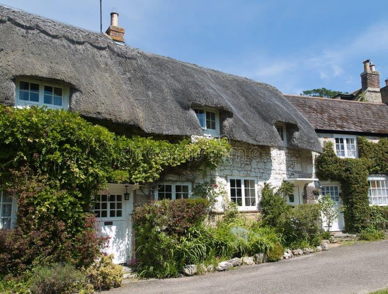 Casas de campo Thatched imagem de stock royalty free