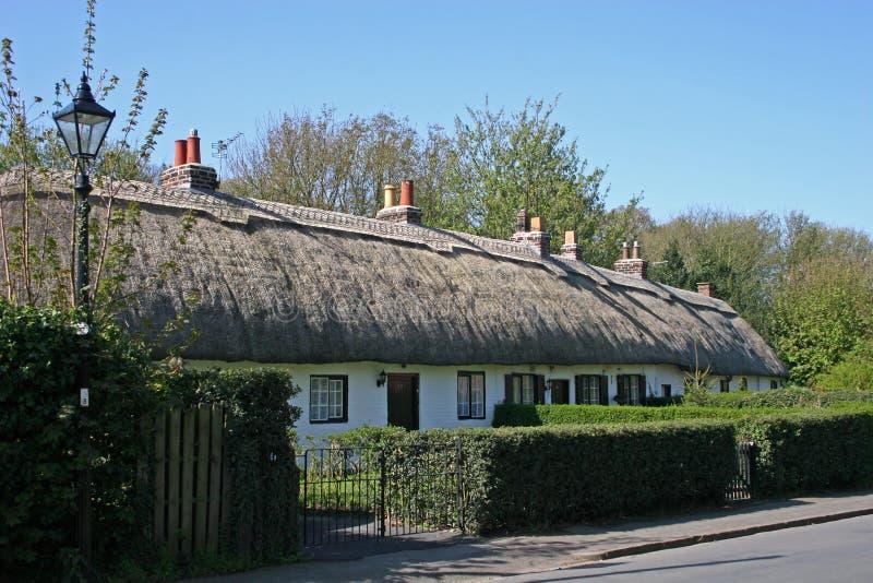 Casas de campo Thatched imagem de stock