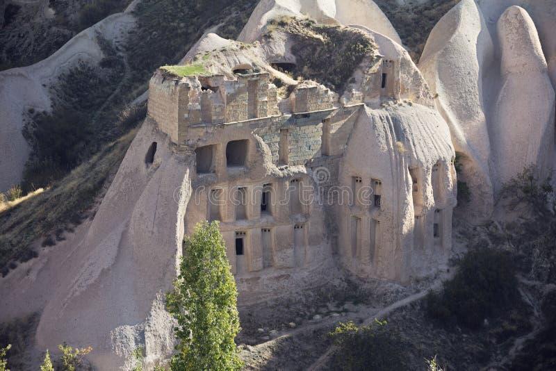 Casas de la cueva en valle de la paloma foto de archivo