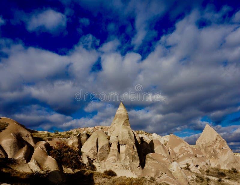 Casas de la paloma y cielos nublados fotografía de archivo libre de regalías