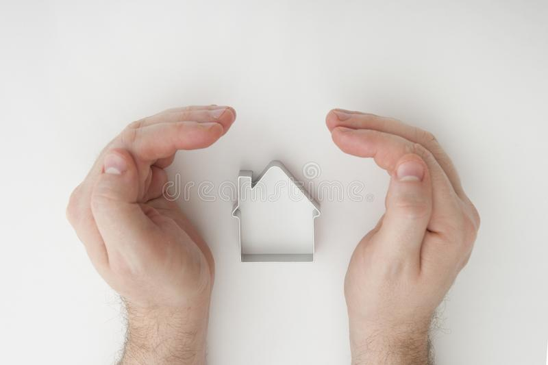 Casas de las propiedades inmobiliarias?, planos para la venta o para el alquiler Protección de las propiedades inmobiliarias segu fotografía de archivo libre de regalías