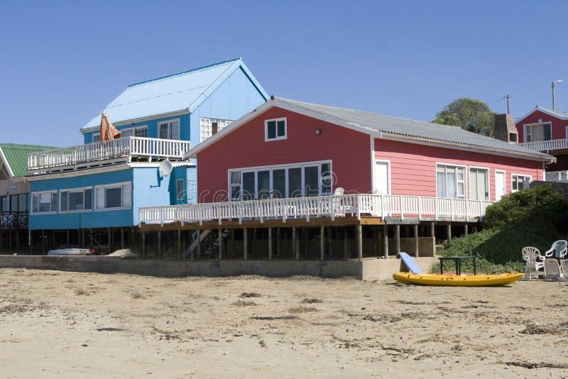 Casas de praia Multicoloured foto de stock
