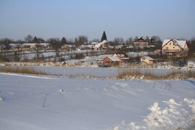 Casas do inverno fotografia de stock