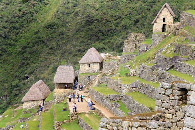 Casas e terraços do fazendeiro de Machu Picchu imagem de stock