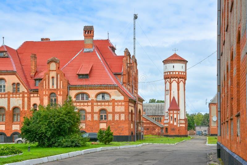 Casas e torre de água alemãs velhas em Prússia do leste fotografia de stock royalty free