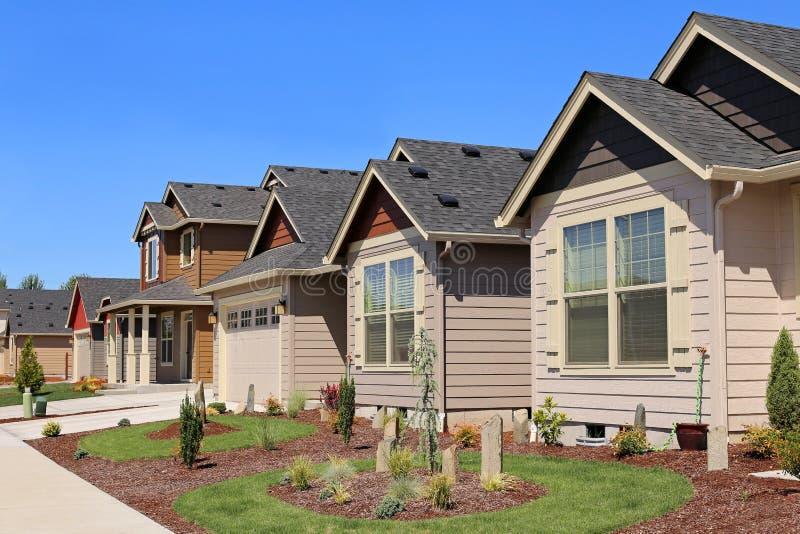 Casas familiares bonitas fotografia de stock