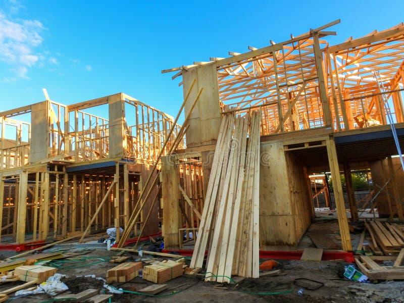 Casas sob a construção fotografia de stock