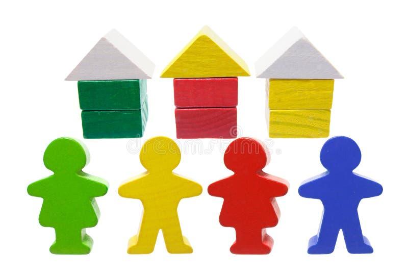 Casas y figuras miniatura fotografía de archivo