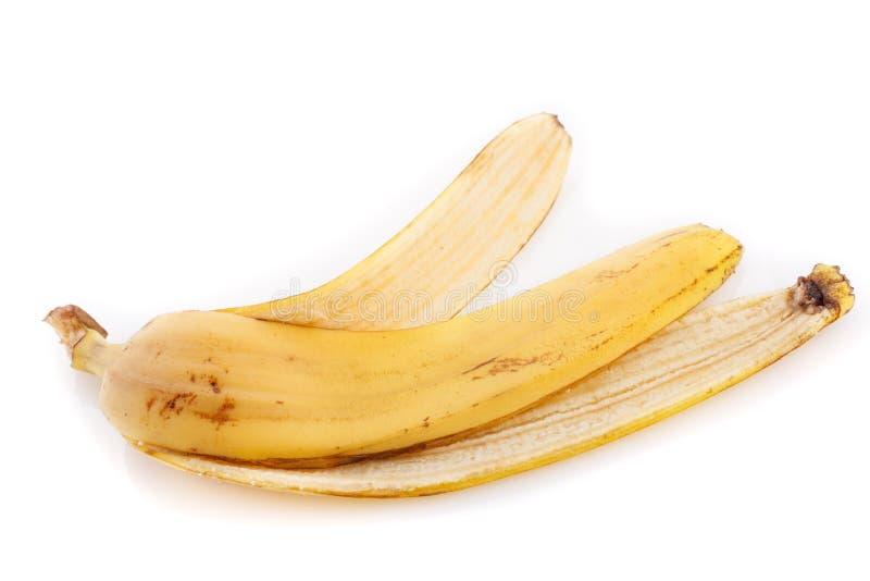 Casca da banana isolada no fim branco do fundo acima imagens de stock royalty free