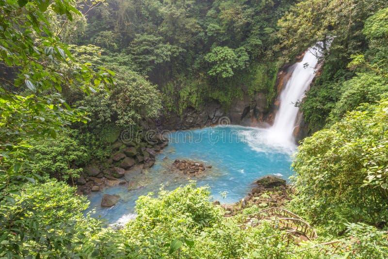 Cascada azul en Costa Rica fotografía de archivo