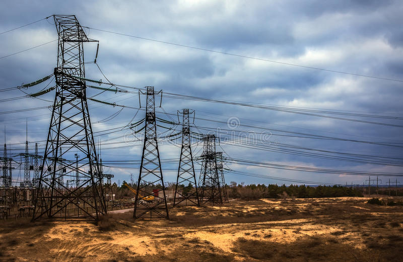 cascade of power lines. electricity distribution station in storm. royalty free stock image