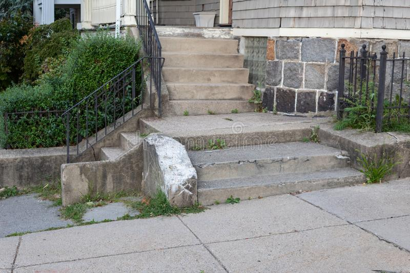 Cascade of residential concrete stairs to a sidewalk royalty free stock photo