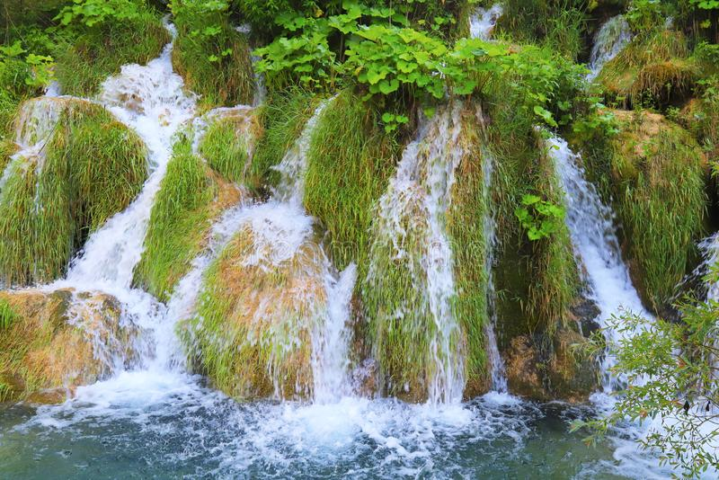 A cascade waterfall among large stones in the Plitvice Lakes Landscape Park, Croatia in spring or summer. Croatian stock photo