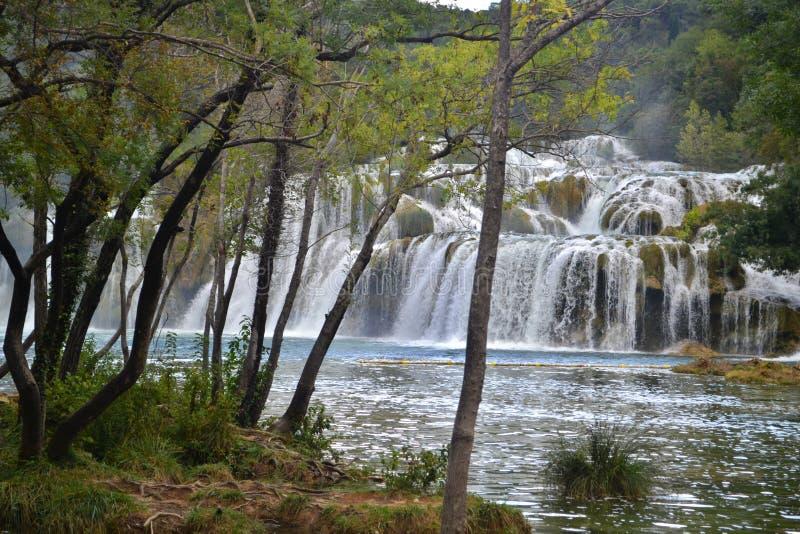 Cascade of waterfalls Skradinski Buk in National Park Krka in Croatia. Summertime, cloudy weather royalty free stock photography