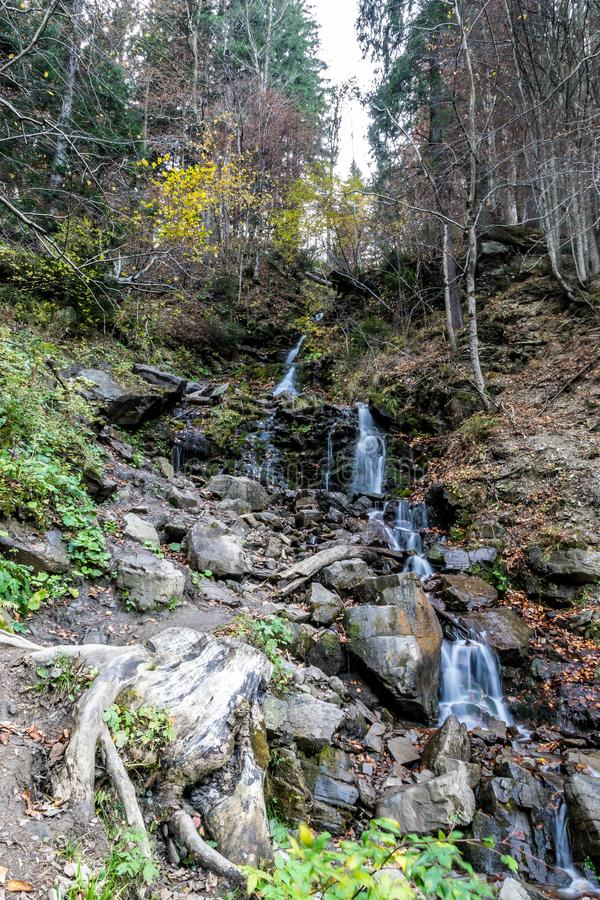 Cascading forest waterfall flow, long exposure stock images