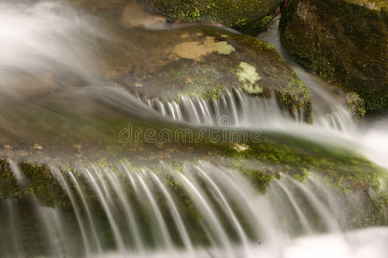 Cascading over rocks royalty free stock photography