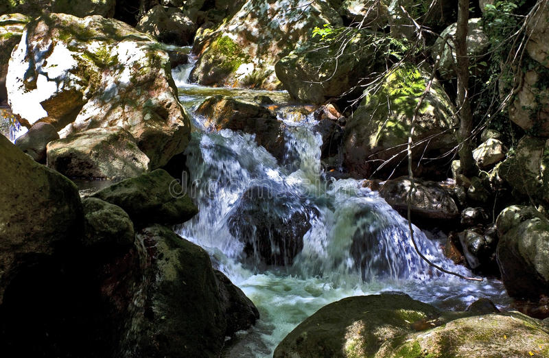 The cascading River Blavet tumbling over the boulders of the Gorges du Blavet royalty free stock image