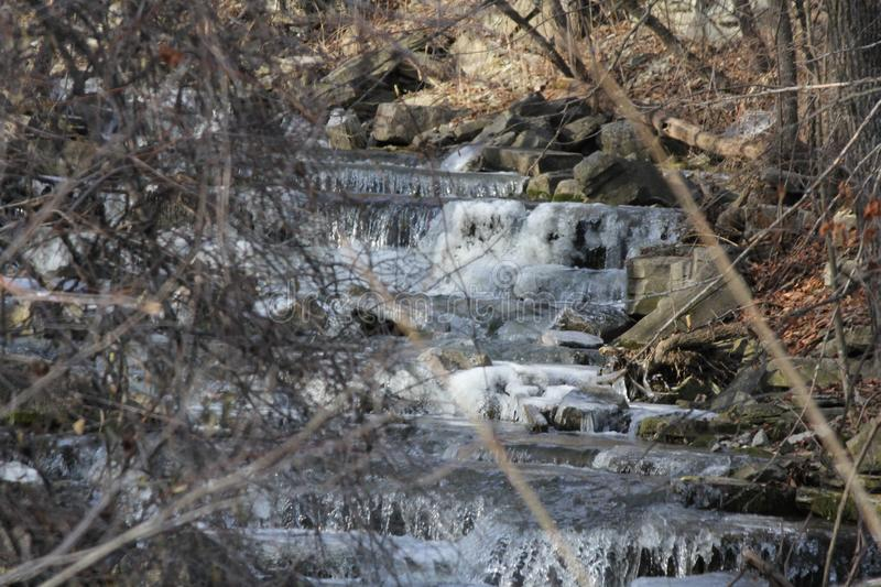 Cascading water starting to freeze stock photos