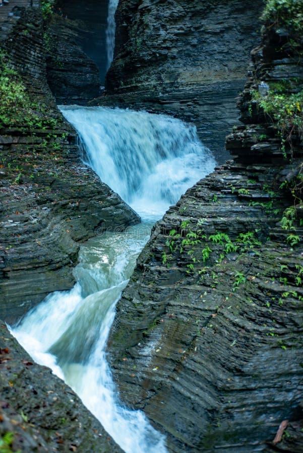 Cascading waterfall into Glen creek in Watkins Glen State Park New york. Warm autumn day. Daylight highlights the rocks on both royalty free stock photos