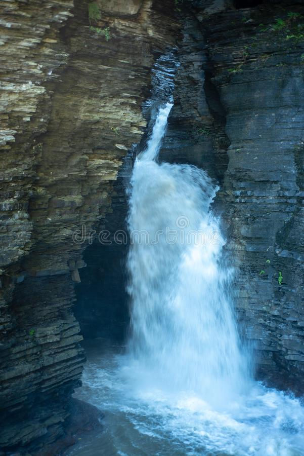 Cascading waterfall into Glen creek in Watkins Glen State Park New york. Warm autumn day. Daylight highlights the rocks on both sides of the creek stock images