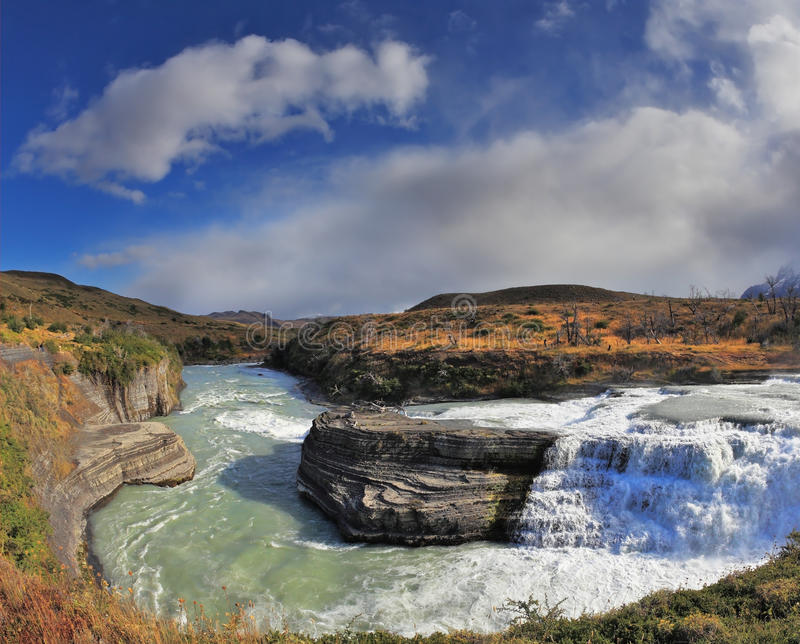 The cascading waterfall - in Patagonia. stock photos