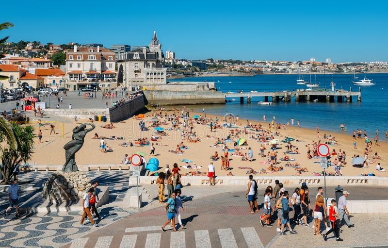 Seaside cityscape of Praia da Ribeira, Cascais. Intimate beach near the train station and popular with tourists. Cascais, Portugal - August 7, 2018: Seaside stock images