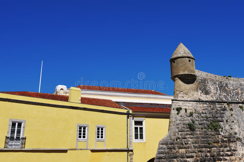 Cascais in Portugal. Fortress wall and yellow plastered houses with red tiles roofs in Cascais, one from most popular resort in Portugal stock photos