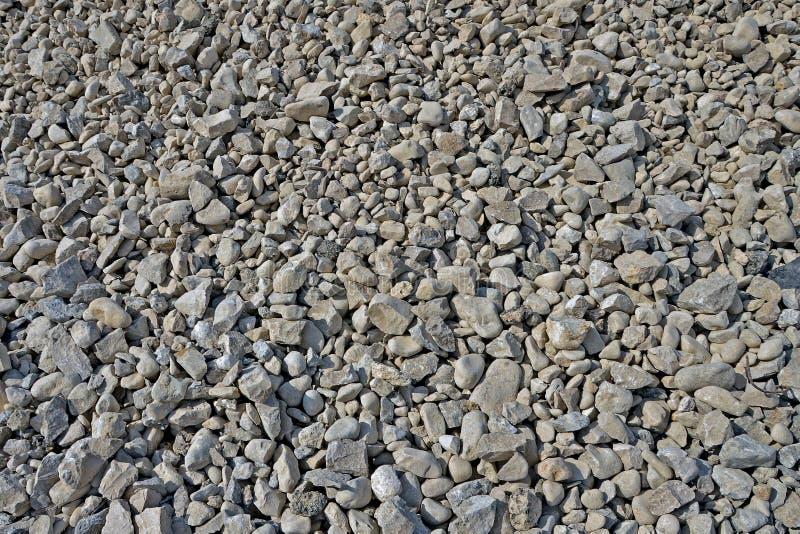 Cascalho da textura sem filtros Material de construção quebradiço, consistindo em partes de rocha do tamanho diferente foto de stock royalty free