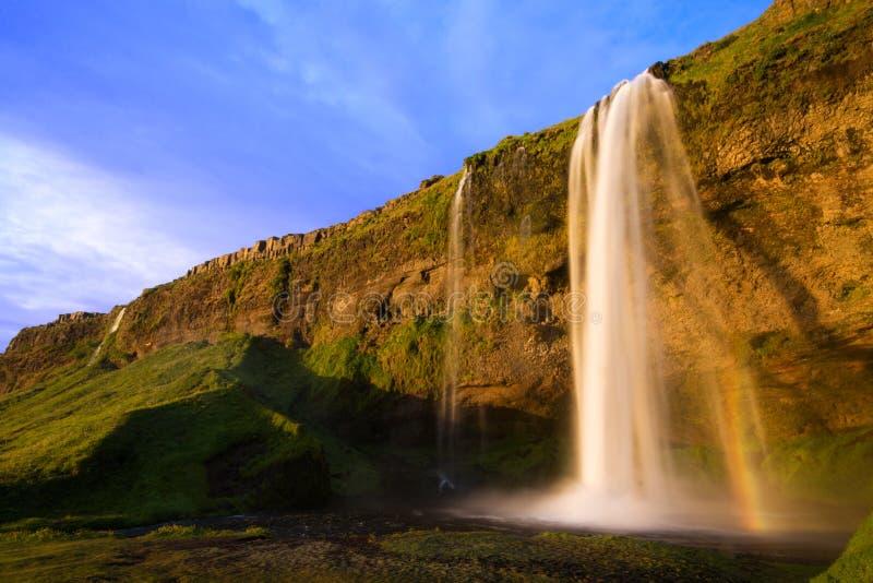 Cascata al tramonto, Islanda di Seljalandfoss fotografia stock