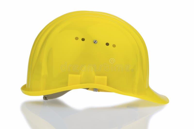 Casco amarillo de la seguridad en el trabajo fotos de archivo