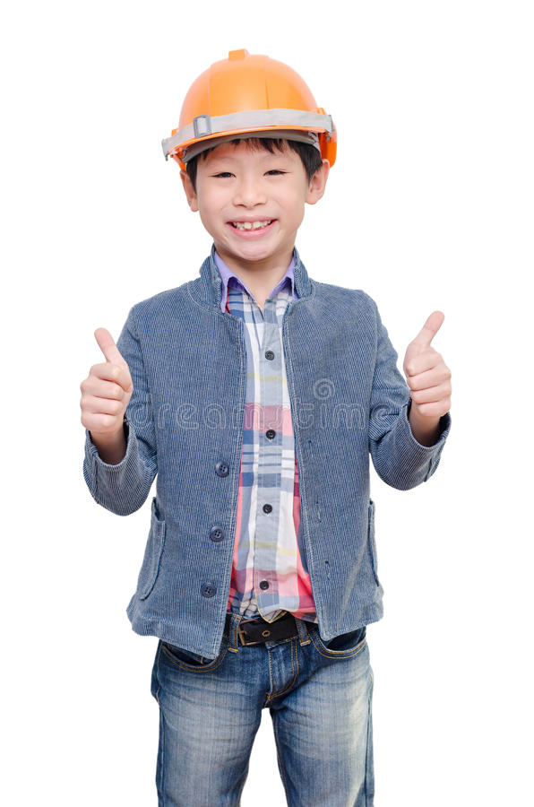 Casco del muchacho y el mostrar que llevan pulgares para arriba imagen de archivo