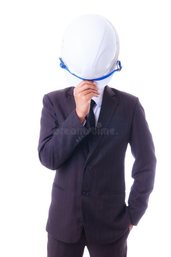 Casco dell'ingegnere della tenuta dell'uomo di affari isoleted immagine stock libera da diritti