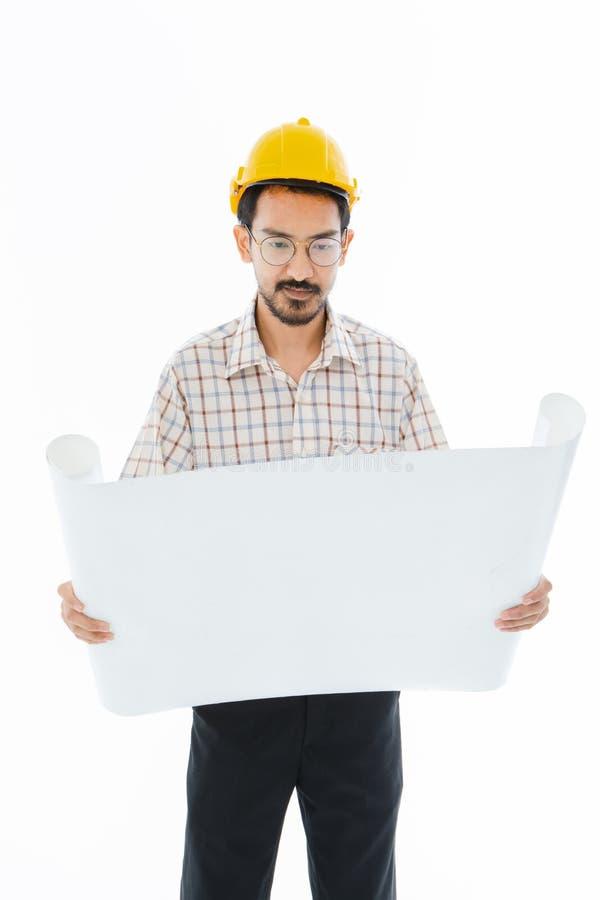 Casco giallo di condizione dell'uomo dell'ingegnere immagine stock