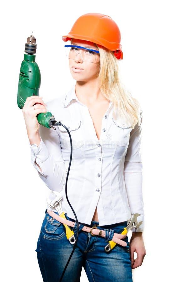 Casco que lleva femenino atractivo y seguridad fotografía de archivo