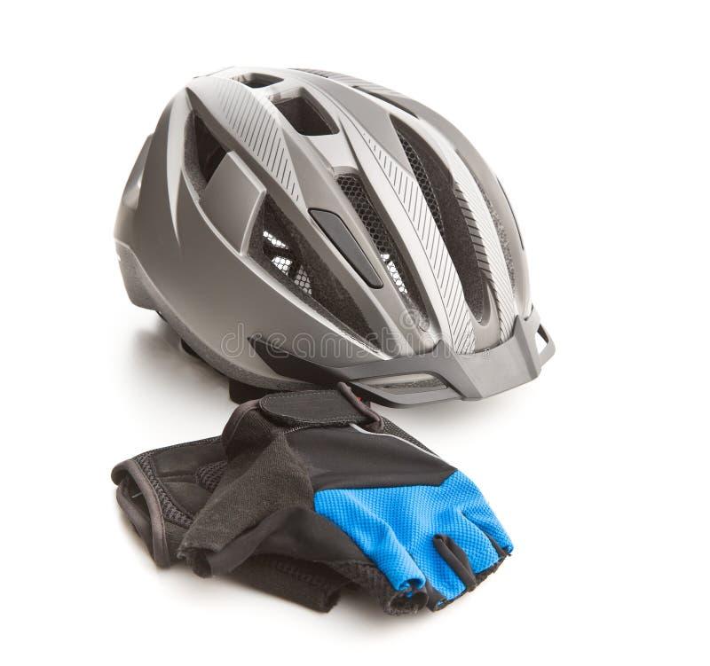 Casco y guantes que montan en bicicleta imagen de archivo