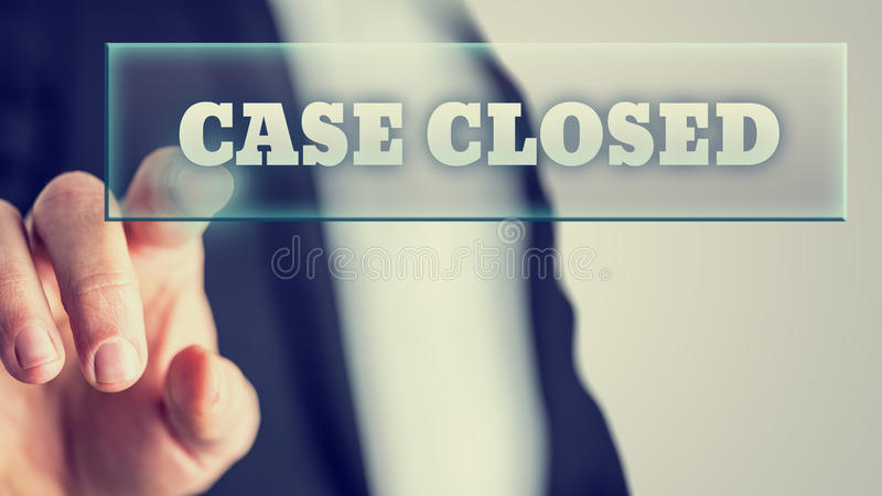 Case closed. Hand of a lawyer activating a Case closed button on virtual screen stock images