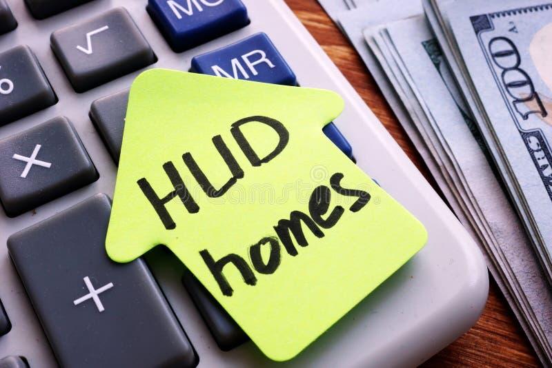 Case di HUD scritte su pezzo di carta fotografia stock