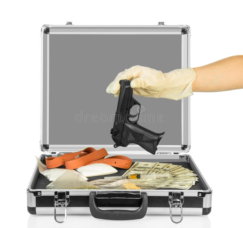 Case with money, gun and drugs. Silver case with money, gun and drugs with hand in glove isolated on white background stock images