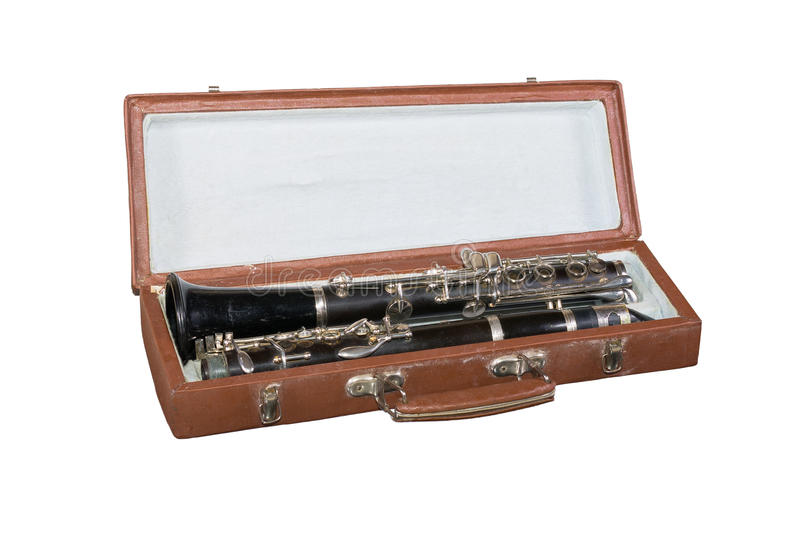 Case with an old clarinet. Isolated on white background royalty free stock image