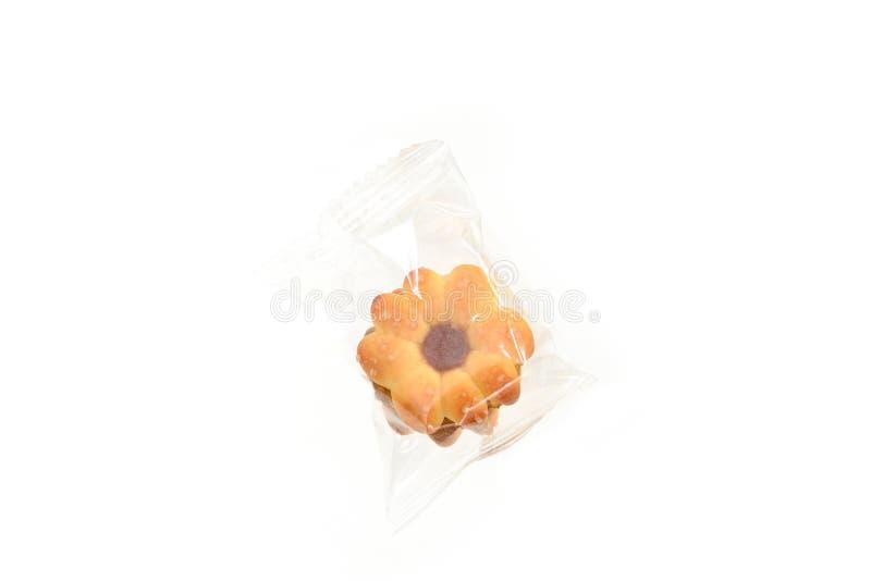 Caseiro enchido com doce do abacaxi no isolado do pacote no branco imagem de stock