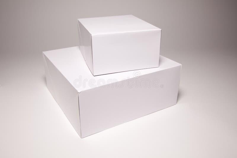 Casella bianca in bianco su Grey fotografia stock