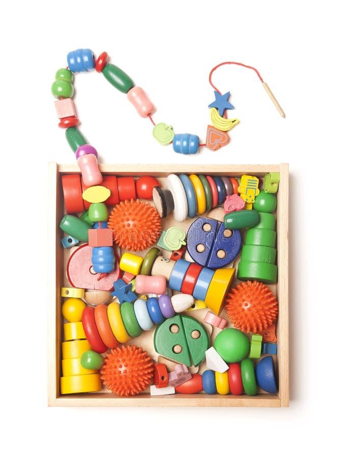 Casella di legno con molti giocattoli fotografia stock libera da diritti